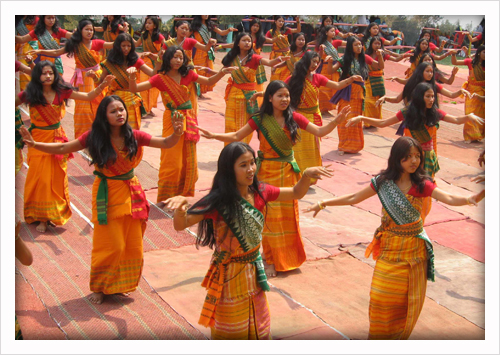 A group of girls performing the Bagurumba dance wearing traditional attires